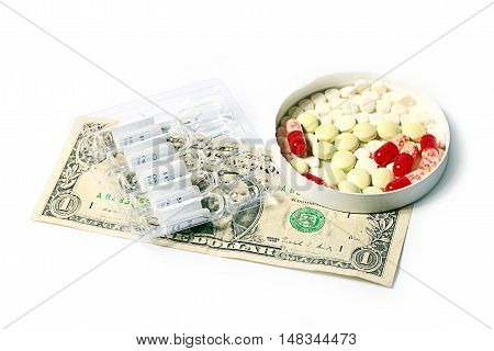 pills, medical ampoules with medicine preparations and dollars