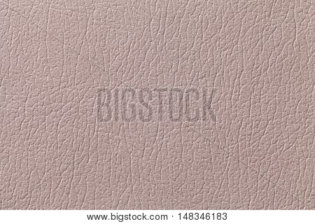 Beige leather texture background with pattern closeup.