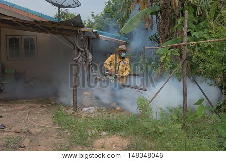 CHACHOENGSAO , THAILAND - SEPTEMBER 1, 2016 : Environmental health workers fogging to eliminate mosquito for prevent spread dengue fever in village. soft focus . , Chachoengsao , Thailand . SEPTEMBER 1 2016 .