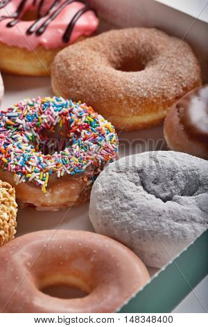 Variety of doughnuts in box
