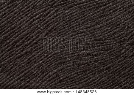Dark brown background from a soft wool textile material closeup. Fabric with natural texture. Cloth backdrop.