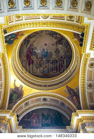 SAINT PETERSBURG RUSSIA - APRIL 25 2015: The painted semi-dome of St Isaac's Cathedral surrounded by gilt carved patterns on April 25 in Saint Petersburg.