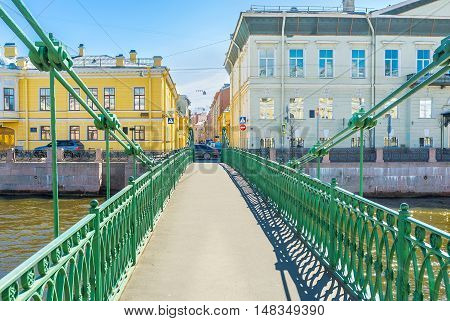 The view on Pochtamtsky Bridge (Postal) across the Moyka River named after Central Post Office (Pochtamt) St Petersburg Russia.