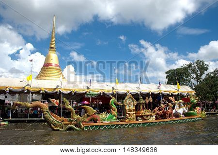 Samut Prakan,Thailand - October 10,2011 : People join the annual Rub Bua (lotus throwing) Festival . Participants throw lotus flowers into a boat carrying Luang Pho To, the main Buddha image of Wat Bang Phli Yai Nai.on October 10,2011,Bang Phli District,