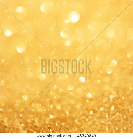 Gold christmas lights background with sparkling bokeh. Abstract defocused boke glitter festive light