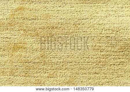 Light yellow background from a soft textile material. sheathing fabric with natural texture. Cloth backdrop.