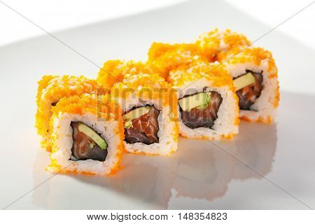 Maki Sushi with Masago  - Roll made of Fresh Raw Salmon, Avocado inside. Masago (smelt roe) outside