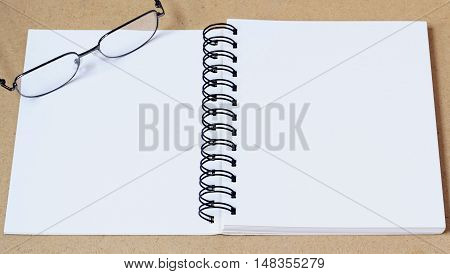Open blank book on brown wooden table