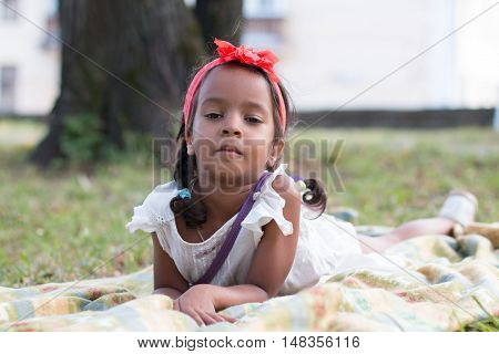 Small Tan Girl Outdoor In A Summer Day