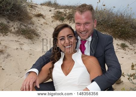Cheerful Married Couple Standing On The Sand