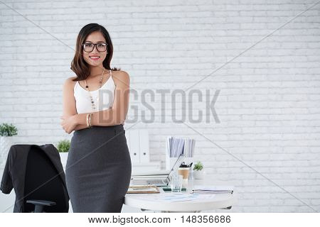Elegant cheerful business lady smiling at camera
