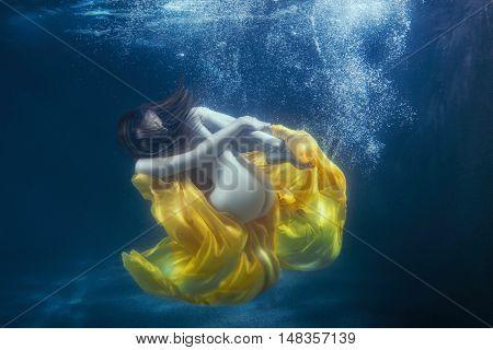 Women's dress develops under water it fantastically dives.