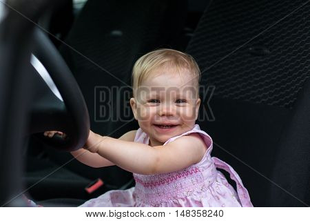 Small Cute Baby In A Car In A Warm Day