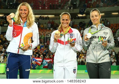 RIO DE JANEIRO, BRAZIL - AUGUST 13, 2016: Petra Kvitova CZE (L), Monica Puig PUR and Angelique Kerber GER during medal ceremony after tennis women's singles final of the Rio 2016 Olympic Games