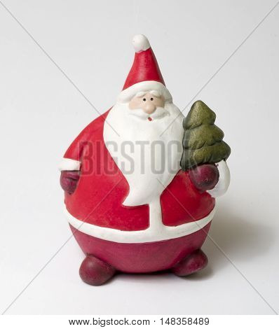Toy Santa Claus figure on white background. Santa Claus. Christmas new year.