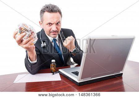 Mad Medic At Office Showing Fist And Pills Bag