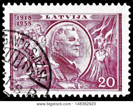 LATVIA - CIRCA 1938 : Cancelled postage stamp printed by Latvia, that shows President Karlis Ulmanis.