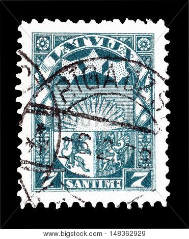LATVIA - CIRCA 1931 : Cancelled postage stamp printed by Latvia, that shows Coat of arms.