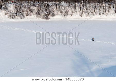 alone man walking on a winter path