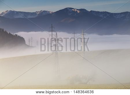 High Voltage Electric Lines In Fog