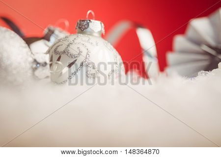 Close up view of christmas bauble against red background