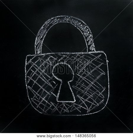 drawn in chalk padlock on a dark background / security technology