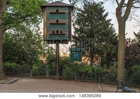 PARIS, FRANCE - MAY 12, 2015: This is a big birdhouse mounted in one of small yards on Montmartre.