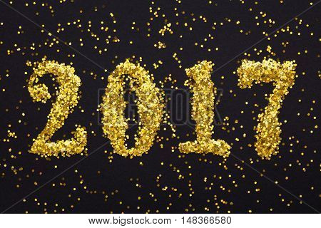 New year decoration,Closeup on golden  sparkles 2017