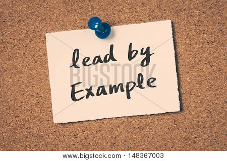 Lead by Example. Note pin on the bulletin board.