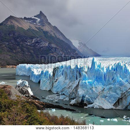 Colossal Perito Moreno glacier in Lake Argentino. Los Glaciares National Park in Argentina. Sunny summer day