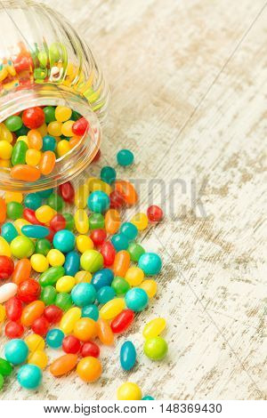 Glass bowl fallen with colorful jelly beans