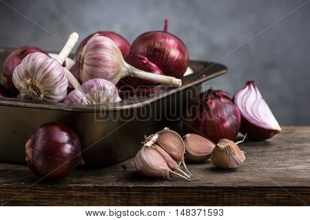 red onion and garlic on a wooden board. still life