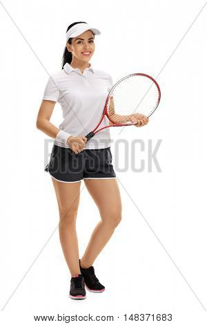 Full length portrait of a female tennis player posing with a racket isolated on white background