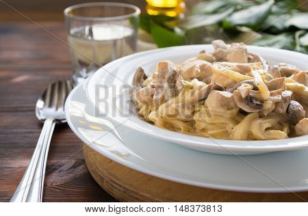 Pasta spaghetti with chicken and mushrooms with copy space