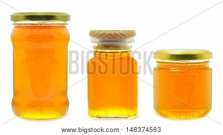 honey in a jar isolated on white background