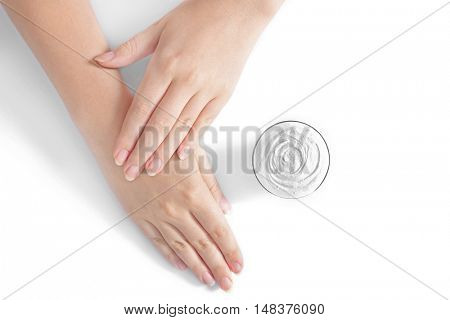 Female hands with cosmetic cream, isolated on white