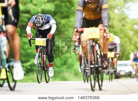 group of cyclist at professional race on the road