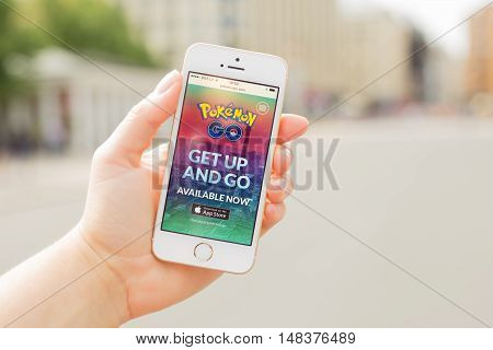 RIGA LATVIA - July 14 2016: Person holding mobile phone and showing Pokemon Go website. Pokemon Go is a location-based augmented reality mobile game.