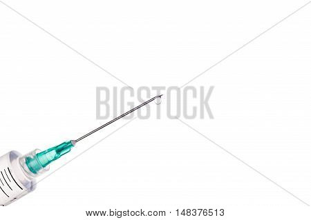 Syringe with drops of transparent liquid on needle. Equipment for injection