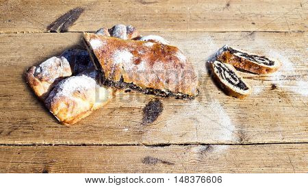 Strudel With Poppy Seeds On A Wooden Table