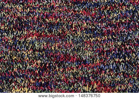 Knitting background texture from colourful yarn, abstract authentic pattern.