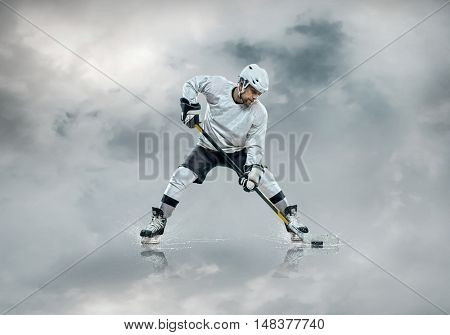 Ice hockey player on the ice around clouds