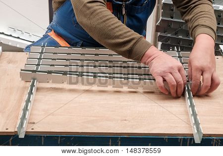 man collects processing cell ceiling, manual labor