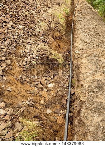 Building Of Lines Of Metallic And Fiber Optic Cables.  Laying Underground Tow Network Connection Cab