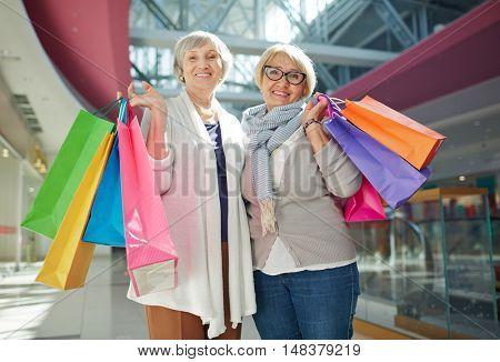 Smiling senior shoppers