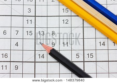 Crossword sudoku and pencils, popular puzzle game with numbers.