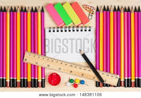 Bright writing materials for learning on a wooden surface close-up