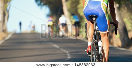 Cyclist athletes riding a race,cycling competition view from behind