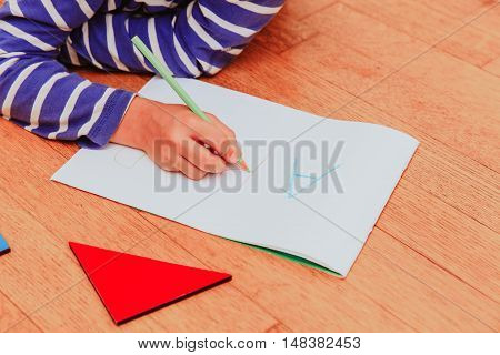 little boy writing letters, early education concept