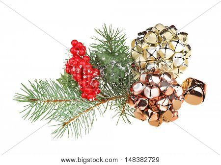 Mistletoe, pine-tree branch and jingle bells isolated on white
